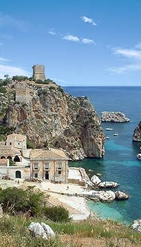 "Scopello (from the Greek ""Skopelos"" meaning ""cliff"") is located near the sea, on the slopes of the Monte Sparagio."