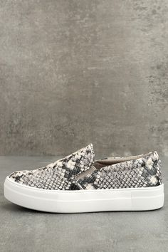 "There's nothing quite like the excitement of stepping out in your new Steve Madden Gills Natural Snake Slip-On Sneakers! Snake print embossed vegan leather shapes these cool girl-approved slip-on sneakers. Metal logo tag at the heel. 1.25"" white bumper sole."