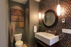 small powder room / I like the colors and the pendant lights. I also like the artwork behind the toilet. Accent wall is awesome!