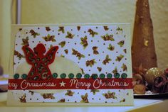 Handmade Christmas card with a red felt sticker of an angel