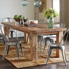 I'd love a slab table top or something raw & natural looking, teamed with industrial style chairs like Tolix chairs. And low hanging feature light :)