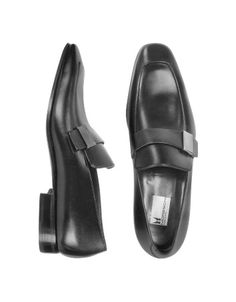 Montecarlo -  Black Calfskin Loafer Shoes - Moreschis stately black loafer shoes showcase beautiful calf leather with a polished sheen and silver logo detail for a look that evokes both contemporary elegance and timeless class. Dust bag included, Made in Italy.