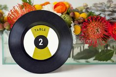 Countdown the greatest hits of your wedding day with these whimsical vinyl record table numbers. Have guests sign the other side and display in a frame for a cool alternative guestbook. Unique Table Numbers, Wedding Table Numbers, Wedding Stationery Inspiration, Wedding Stationary, Wedding Inspiration, Retro Table, Rock And Roll, Wedding Styles, Wedding Ideas