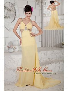 Exquisite Light Yellow Empire Evening Dress Straps Chiffon Beading Brush Train  http://www.fashionos.com  Sexy, sexy and sexy are the only words to describe this dress. Embellished straps with shimmering beadings and outlined cuts highlight the whole spice look. The tremendous beadwork and sexy design is sure to push you in the spotlight. The open waist trimmed in the same bead-embellishments as the straps is good for accentuating the waist and showing off your slimeline.