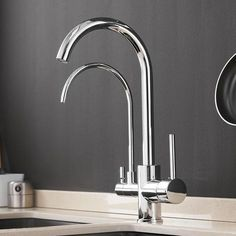 This stunning double crane faucet is the perfect combination of modern design and convenience.Faucet includes one tap for hot and cold water & another for purified water.Easy to install. Stainless Steel Faucets, Brass Faucet, Double Kitchen Sink, Waterfall Faucet, Purifier, Rainfall Shower, Simple Bathroom, Bathroom Ideas, Restroom Ideas
