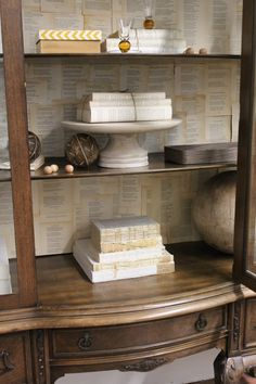 I added old book pages to back of cabinet Old Book Pages, Old Books, Design Ideas, Shelves, Cabinet, Home Decor, Antique Books, Shelving, Clothes Stand