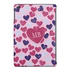 An iPad Mini Retina case with a grunge love heart pattern with hearts in shades of pink and purple and a large love heart in the centre to add your initials to create a monogram design. Perfect for a gift for the one you love!