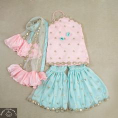 This Aaisha Girls Pink and Blue Sharara and Choli Set is elegant party wear attire. Kids Indian Wear, Kids Ethnic Wear, Indian Baby, Girls Dresses Online, Dresses Kids Girl, Baby Dresses, Stylish Dresses For Girls, Kids Frocks Design, Baby Frocks Designs