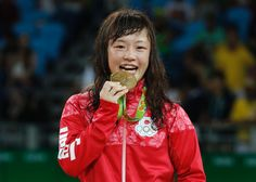 Japan's Eri Tosaka celebrates on the podium after winning in the women's 48-kg…