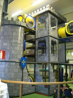 Castle themed indoor playground structure by International Play Company