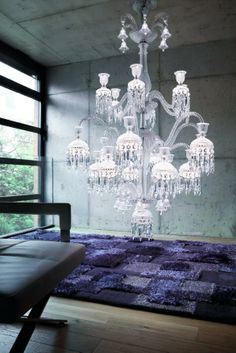 Chandeler combines tradition and new technologies. Its design follows up the Baccarat crystal chandeliers, but contains modern LED diodes.