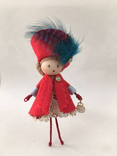 Put your brooch doll by MISCHIC on your sweater, jacket or shawl and take magic with you wherever you go! MISCHIC Brooches are charming companions for everyone who loves handmade little treasures and small details. These brooches jewelry is completely handmade. The heads and hair of the miniature dolls are made by hand with high quality materials, the tiny dresses are hand-sewn from exclusive fabric and the bodies are made with metal, making them firm and safe to wear. The shoes, hairdress…