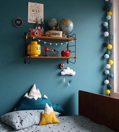 Gorgeous moody teal blue in boys room