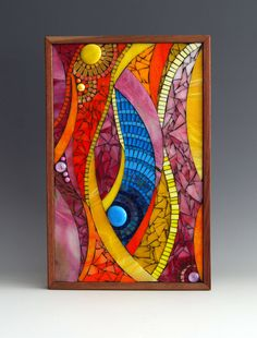 Mosaic wall panel in oranges, pinks, and aqua blues with glass beads on wood panel.
