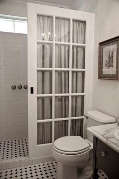 Old french pocket door used instead of an expensive glass shower enclosure. Shower curtain looks like curtains. Old french pocket door used instead of an expensive glass shower enclosure. House Design, Glass Shower, Small Bathroom, French Pocket Doors, Glass Shower Enclosures, Bathrooms Remodel, Home Diy, Bathroom Design, Pocket Doors