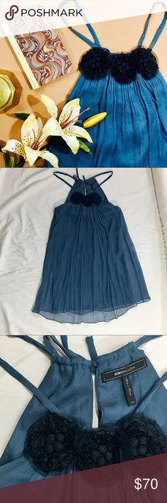 BCBG Maxazria silk dress Beautiful slate blue 100% silk dress with black floral embellishment. Great for wedding guest. Ties at back of neck. BCBGMaxAzria Dresses