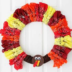 Looking for ideas for Thanksgiving wreaths? Try to make this turkey wreath with bandannas! A quick and easy idea you can make in minutes!