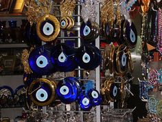 Blue Eyes (Nazar amulets), sold as protection against the evil eye.  ~~~  It is common in Turkey, Syria, Armenia, Iran, Afghanistan, Greece, Cyprus and Azerbaijan. In Armenia, the nazar is often hung in homes, offices, cars, children's clothing, or incorporated in jewelry.    A typical nazar is made of handmade glass featuring concentric circles or teardrop shapes in dark blue, white, light blue and black, occasionally with a yellow/gold edge.