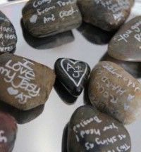 River Rock guest book idea? everyone can sign a river rock with a permanent marker there name on one side and a little message on the other...I will have different sized rocks and put it into a tall vase then after the wedding I can take it home and put it on a shelf with some flower...I love River Rocks and thought this would be a good idea