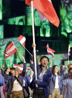Olympic teams march in Parade of Nations: Celebrating the big moments - Jia Liu carries the flag of Austria during the opening ceremony for the 2016 Summer Olympics in Rio de Janeiro, Brazil, Friday, Aug. 5, 2016. (AP Photo/David Goldman)