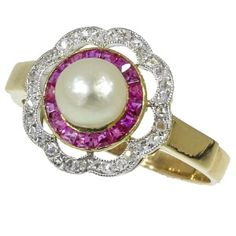 Most charming Art Deco engagement ring with rubies rose cut diamonds and a pearl