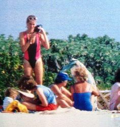 Princess Diana taking a picture.