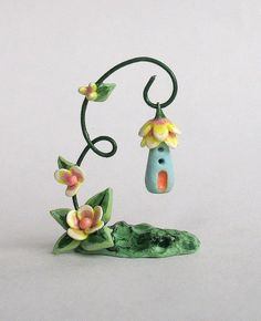 Pinning for th idea of the wire hanger idea-- Polymer clay stand with house pendant/ornament