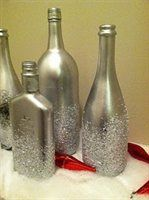 Spray paint wine bottle silver then dry. Apply glue and sprinkle with crushed Epsom salt. Maybe with some kind of silk blue flower.