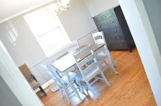 Dining room set from country to neutral gray for a more modern gray design.  The rooms isn't finished