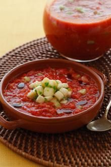 Traditional Spanish gazpacho, a fresh chilled soup of tomatoes and cucumbers, gets a unique twist when topped with delicious Chiquita Banana salsa. Garnish Recipe, Chilled Soup, Food Garnishes, Gazpacho, Banana Recipes, Soups And Stews, Tomatoes, Dairy Free, Nom Nom