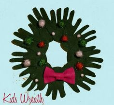 Christmas Crafts for 2 Year Olds   Check out this handprint wreath from Domestic in the City . I love it!