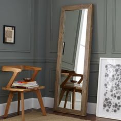 Add a reflective touch to your room with this beautifully finished wooden mirror