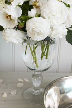 Love the white flowers in a simple glass vase. It makes the look crisp-clean and elegant.