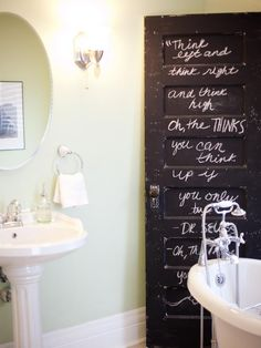 Everyday objects can become focal points in your bathroom if you look at them with an artist's eye. When the design team at Birdhouse Interior Design opted not to use an original door in this 1910 farmhouse remodel, they repurposed it as an art piece in the bathroom. It's coated in chalkboard paint and scrawled with a whimsical Dr. Seuss quote. Photo by Dana Damewood
