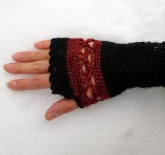 These fingerless mitts are warm around the wrist and feature a wide lace panel around the palm in a contrasting color. I designed them to...