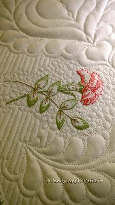 Carnation - FMQ on vintage embroidery table runner