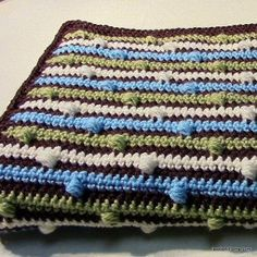 The Beautiful Puff Stitch Baby Blanket is perfect for a boy or a girl. Practice your puff stitch with this crochet baby blanket pattern | AllFreeCrochetAfghanPatterns.com