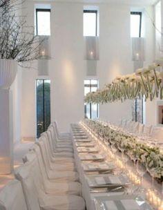 Floating Flowers in an all white wedding. Pretty and unique. Floating Flower Centerpieces, Picture Wedding Centerpieces, Hanging Centerpiece, Floating Flowers, Hanging Flowers, White Centerpiece, Floating Candles, Low Centerpieces, Hanging Vases