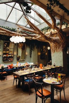 Talk about an incredible statement piece, Ober Mamma restaurant in Paris is doing it right! They have turned a typically normal space into something exciting and interesting! It has a real Biophilic vibe. And those orange and blue wooden chairs... Everything about this place screams excitement.