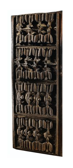 Africa | Door from the Yoruba people of Nigeria | Wood | Attributed to the workshop of the famous Yoruba master sculptor Olowe of Ise (born 1873), who worked mainly for members of the Yoruba aristocracy.