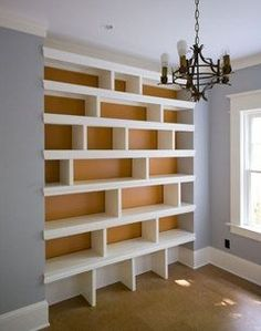 Alcove storage solution - staggering shelf dividers gives a contemporary look. To keep it uber chic, fill with same or similar colour accessories or books.