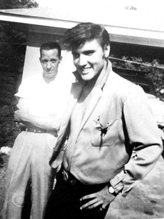 Elvis in Memphis summer 1956 wearing his green jacket.