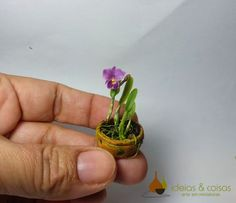Miniature Cattleya orchid. Crafted in cold porcelain modeling clay.