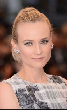 Diane Kruger wore Boucheron's Envoutant Sillage earrings in white gold set with for the closing ceremony and presentation of the Palme d'Or at Canne Film Festival.
