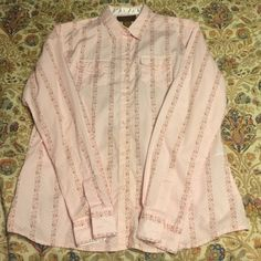 Pink button down with floral and polka dot detail. Cute pink button down. Pattern is alternating rows of small paisley/floral pattern and polka dots. Tops Button Down Shirts
