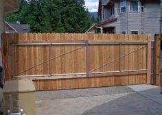 Cedar Fencing Plus Custom steel gates and brackets for wood fences. Install Chain Link and Wood Fencing. Sliding Fence Gate, Cedar Fence, Wood Fences, Fencing, Gate Wall Design, Home Electrical Wiring, Carport Designs, Gate Hardware, Wooden Gates