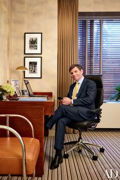stephanopoulos office The desk chair is by Humanscale, the Ralph Lauren Home desk features an RH Modern lamp, and the photographs on the wall are by Henri Cartier-Bresson