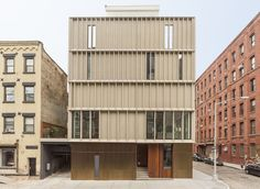 New York firm Alloy has completed a row of skinny houses in Dumbo, Brooklyn with a concrete, wood and steel facade meant to reference industrial buildings Wood Facade, New York Architecture, Building Facade, Facade Design, Skylight, Cladding, Townhouse, Brooklyn, Corner