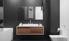 salle de bains moderne et sombre avec une mosaïque murale noire et blanche et un meuble sous-vasque en bois et blanc
