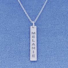 This chic and special Sterling Silver Name Engraved Vertical Bar Charm Pendant with high polished finish can be engraved with any name or word up to 8 letters of your choice. This bar pendant in fine quality Sterling Silver is cut out by latest technology laser machine with top quality guaranteed and hangs on a classic Rollo chain. The chain can be optional and all the letters are capitalized.